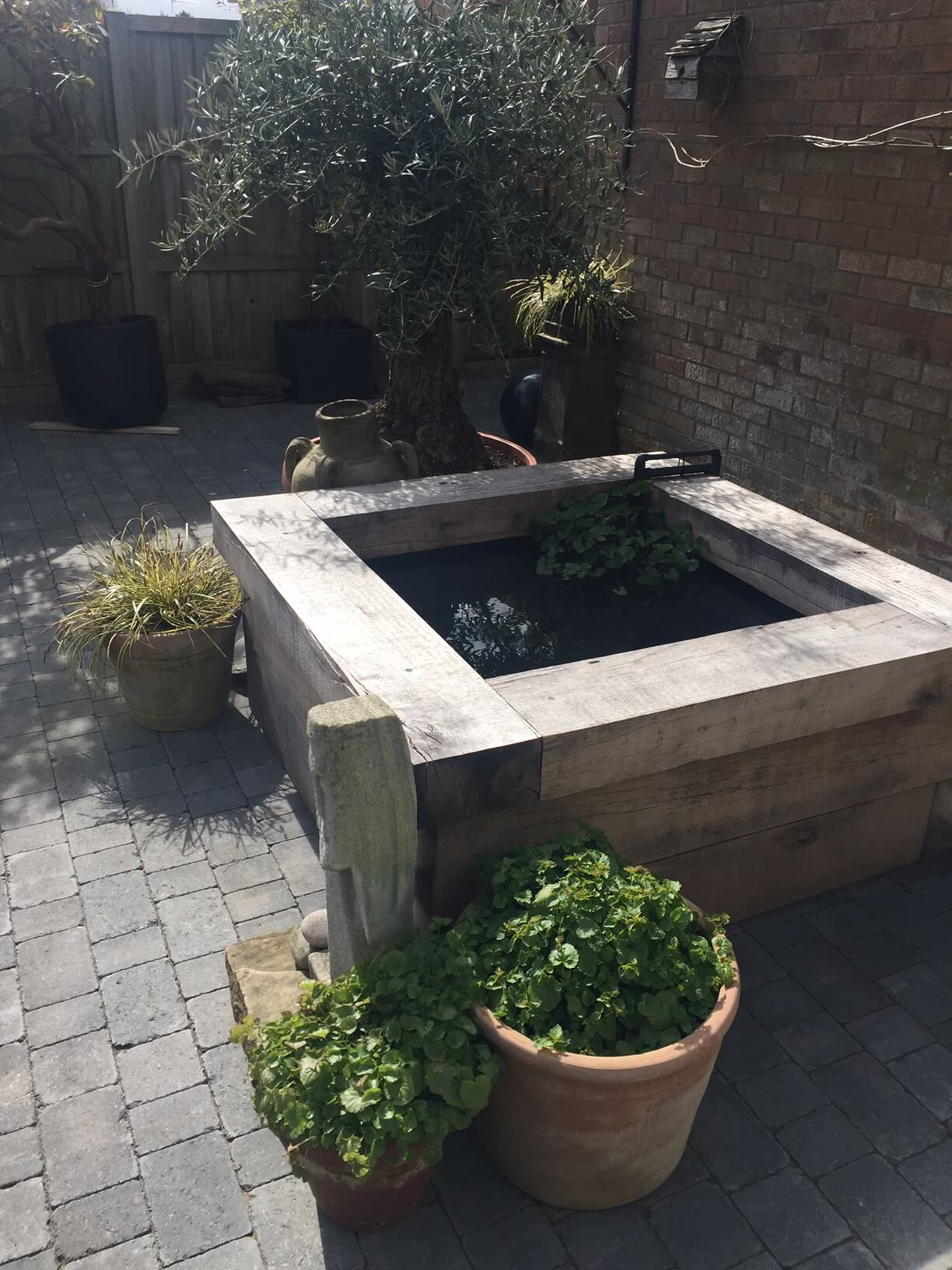 Garden pond built with oak railway sleepers
